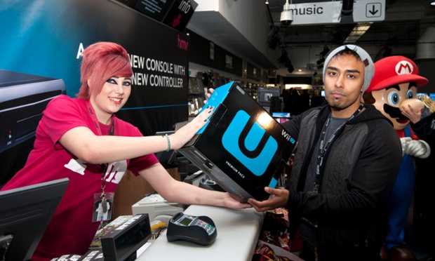 I hope it's worth the wait! Izzy Rahman, the first to buy the Nintendo Wii U from the HMV store on London's Oxford Street, poses with the new games console after queuing for six days.