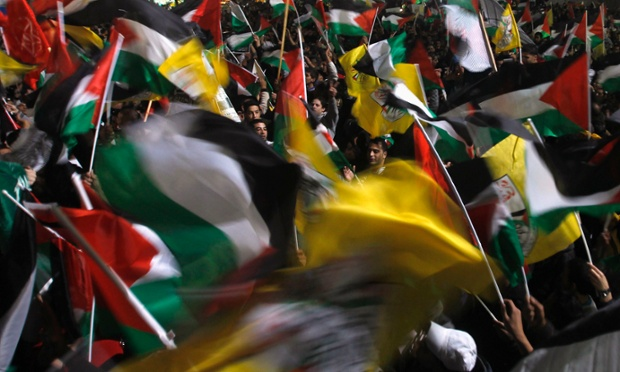 Palestinians wave flags in the West Bank city of Ramallah as they celebrate the UN General Assembly's decision to recognise a Palestinian state.