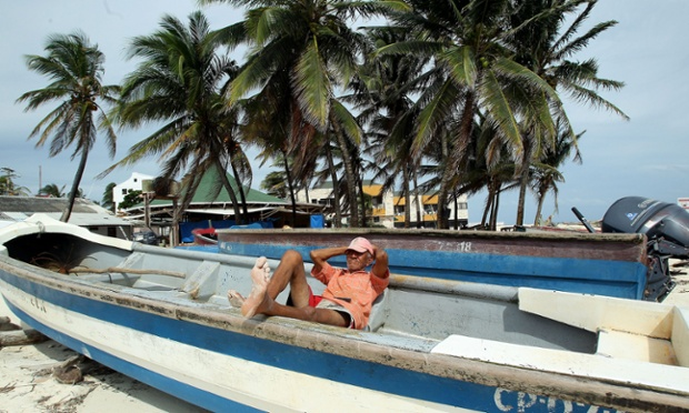 A fisherman rests in his boat in San Andres Island, Colombia. Fishermen on the island have stopped working due to fears regarding the ongoing conflict between Colombia and Nicaragua about their maritime borders.