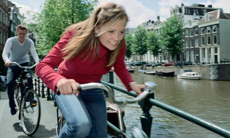 Young people cycling in Amsterdam