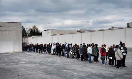 People wait in line for early voting in the parking lot of the Northland Park Center on 4 November 2012 in Columbus, Ohio.