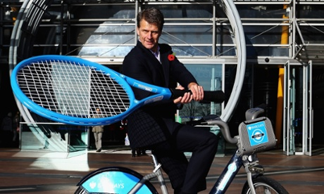 Former British tennis No. 1 Andrew Castle poses with a Barclays Cycle Hire bike on the opening day of the ATP World Tour Finals at the O2 Arena