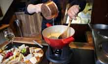 Making cheese Fondue at L'Art du Fromage restaurant, Chelsea