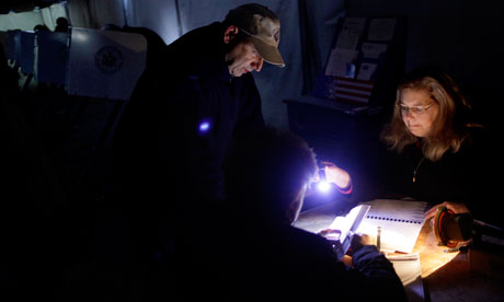 US voting: Poll worker helps voters by flashlight, New York