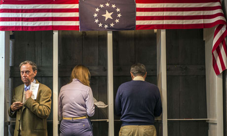 US voting: People cast their ballots inside a polling station just after midnight, New Hampshire