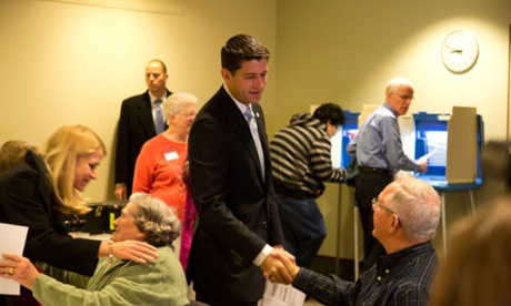Paul Ryan greets a poll worker as he votes with his family in Janesville, Wisconsin.