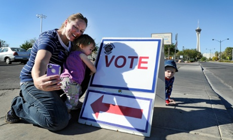 Jaime Lea photographs herself and her children after casting her ballot at John Fremont Middle School on  in Las Vegas, Nevada.