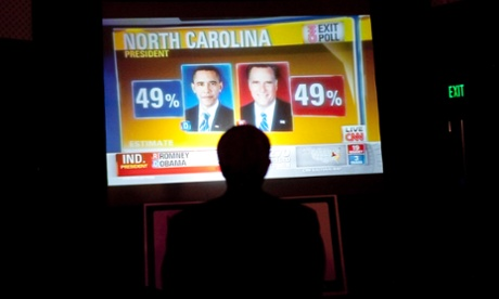 An attendee watches election results at the 2012 election night reception sponsored by the Republican Party of Florida.