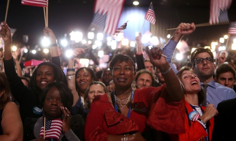 Supporters cheer as President Barack Obama delivers his rousing victory speech.