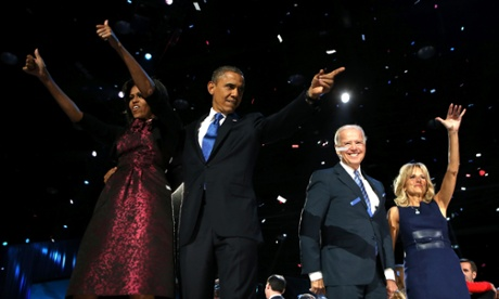 Barack Obama celebrates with Michelle, Joe and Jill Biden on stage after his speech.