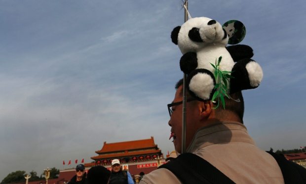 A man carries a toy panda at Tiananmen Square in Beijing, China. The Chinese Communist Party's 18th National Congress is scheduled to begin tomorrow in the Chinese capital. The once-a-decade event installs a new leadership to run the world's second largest economy and newly assertive global power.
