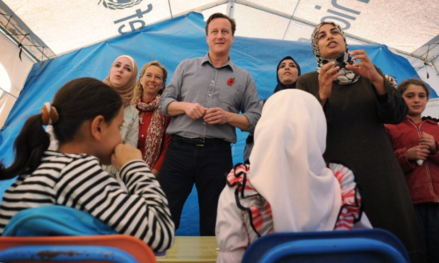 Prime Minister David Cameron meets children and teachers in a classroom at the Za'atri refugee camp near the Syrian and Jordanian border where he met Syrian families who have escaped across the border into Jordan from the Assad regime.