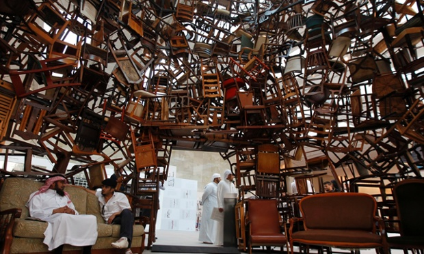 Visitors sit within an installation titled