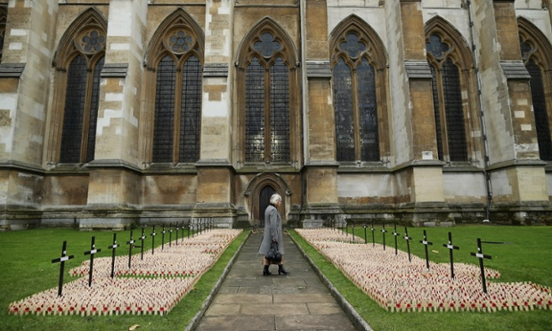 A woman looks at remembrance crosses outside Westminster Abbey ahead of the official opening of the Royal British Legion's Field of Remembrance.