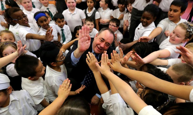 Scotland's First Minister Alex Salmond get down with the kids, slapping high fives school on a visit to St Patricks Primary School in Glasgow. He visited them to help celebrate the school's 50th birthday.