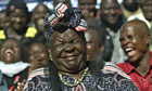 Sarah Obama, step-grandmother of President Barack Obama, reacts with members of her family in Kenya