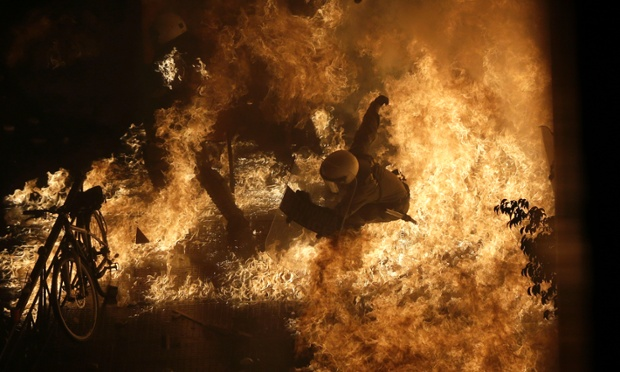 And an unfortunate riot police officer gets engulfed by petrol bomb flames thrown by protesters in front of the parliament in Athens.