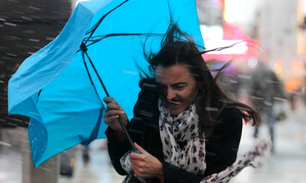 A woman struggles with her umbrella in the wind and snow in New York. A wintry storm dropped snow on the Northeast and threatened to bring dangerous winds and flooding to a region still climbing out from the devastation of superstorm Sandy.