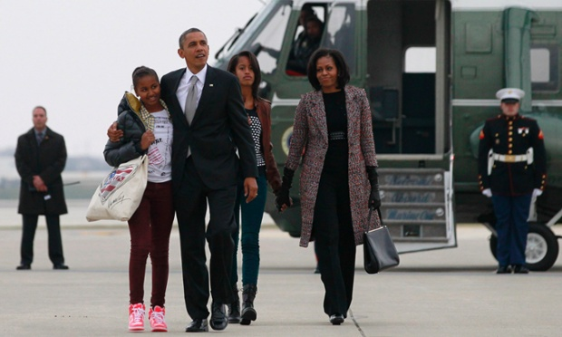 U.S. President Barack Obama first lady Michelle Obama and their daughters Malia and Sasha walk to Air Force One in Chicago following the U.S. presidential election. The first family are returning to Washington following Obama's second term win. Photograph: Jason Reed/Reuters