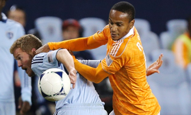 Sporting Kansas City's Oriol Rosell and Houston Dynamo's Ricardo Clark