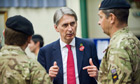 Defence secretary Philip Hammond talks to soldiers doing Territorial Army signals training