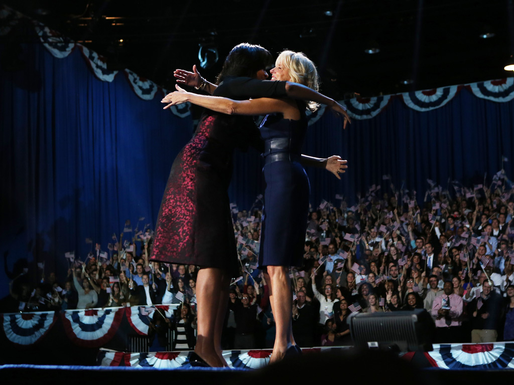 First lady Michelle Obama and Dr. Jill Biden embrace after Barack Obama's victory speech, Chicago
