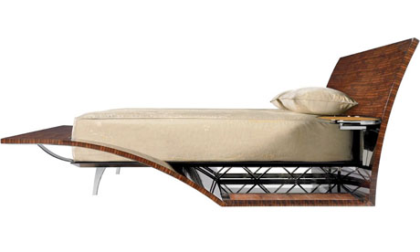 A bed that features nickel feet, trusses, and side tables with silk-under-glass tops.