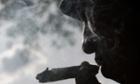 A man smokes marijuana during the International Day for the Legalization of Marijuana.