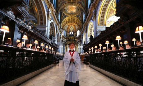 Harry Jackson, 13, the head chorister at St Paul's Cathedral School sings Christmas carols during a photo call inside the Cathedral in London. This is a busy time of year for the choir who will sing to over 20,000 people over the Christmas period.