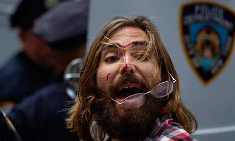 An Occupy Wall Street activist yells at friends after being arrested during demonstrations