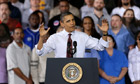 Barack Obama gestures as he speaks to workers about the economy