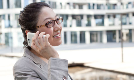 A businesswoman on her mobile phone