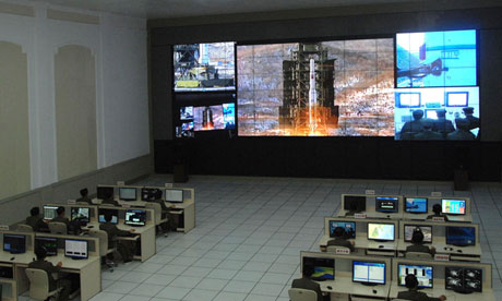 North Korean scientists watch launch of Unha-3 rocket