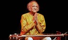 Ravi Shankar salutes the audience during a concert at the Barbican centre, London