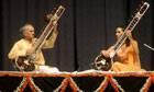 Performing with his daughter Anoushka, 2004.