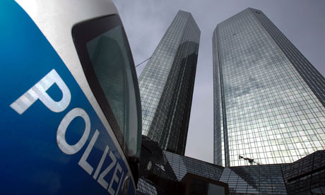 A police car stands in front of the Deutsche Bank headquarters in Frankfurt