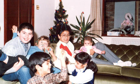Remona Aly's family at Christmas, the tree in the background and Remona bottom right.