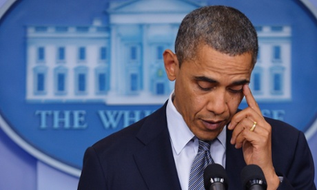 Barack Obama wipes a tear from his eye as he speaks following the Newtown school shooting.