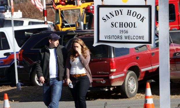 Parents walk away from Sandy Hook elementary school in Newtown, Connecticut, following a shooting there.