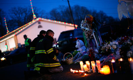 Firefighters visit a memorial at Sandy Hook elementary school in
