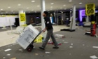 A worker wheels electrical goods across an empty shop floor at a Comet store in Leicester, UK. Comet will close its remaining stores for the final time on Tuesday as part of a deal that will cost the government more than £23m.