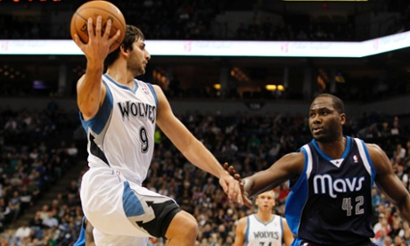 Minnesota Timberwolves point guard Ricky Rubio (9), of Spain, passes the ball around Dallas Mavericks power forward Elton Brand (42) during the first half on an NBA basketball game on Saturday, Dec. 15, 2012, in Minneapolis. Rubio is making his season debut after recovering from surgery on his left knee. (AP Photo/Genevieve Ross)