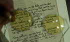 John Lennon's yellow tinted glasses with the original lyric manuscript for All You Need is Love