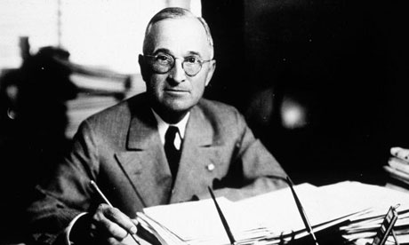 Harry S Truman, the 33rd president of the United States, works at his desk in 1945.