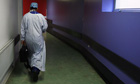 Surgeon walking in hospital corridor