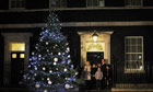 David Cameron in Downing Street with Christmas tree