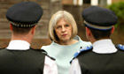 Theresa May with members of a neighbourhood policing team