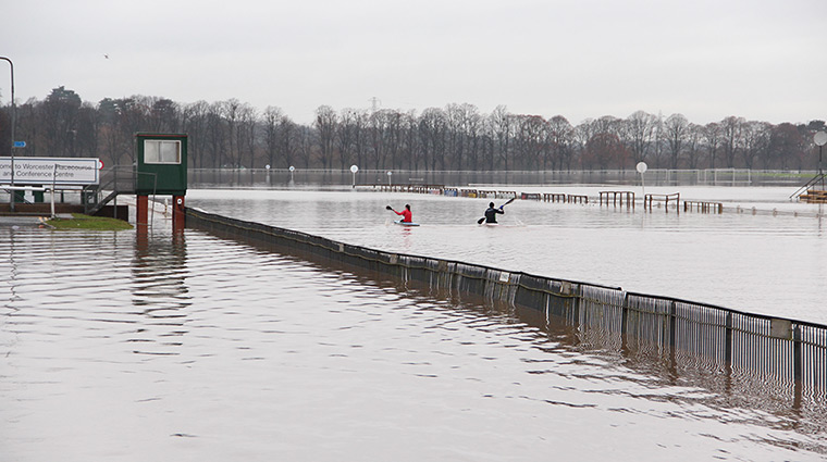Wet weather: Kayakers train on a flooded Worcester Racecourse