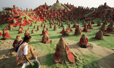 500 Santa Claus sand sculptures on the beach of Puri