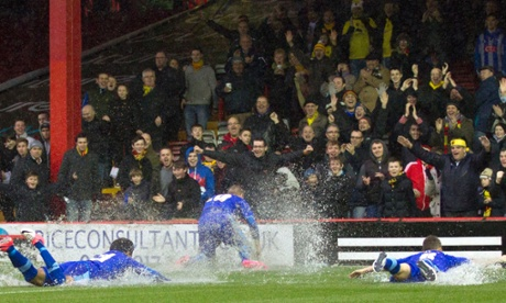 Watford players celebrate the postponement of their match at Bristol City.